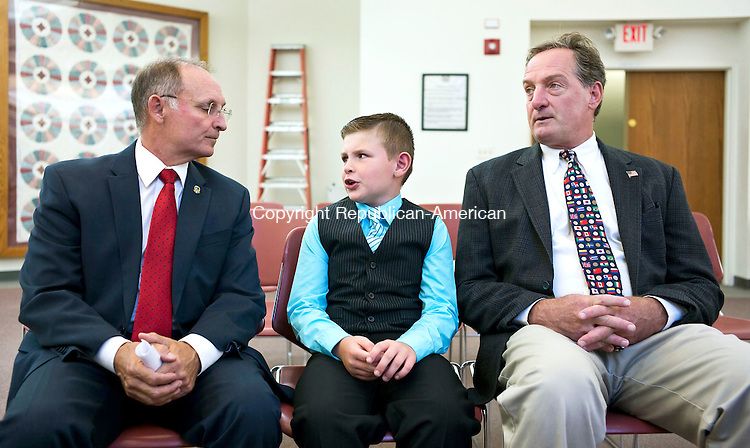 """Harwinton, CT- 30 September 2015-093015CM13- Chad Edmond, 8, of Harwinton, talks with State Senator, Henri Martin (R-36), left, and State Representative John Piscopo (R-76) at the Harwinton Town Hall on Wednesday.  Edmond was named """"Selectman of the Day"""" after participating in the summer program, """"Readers are Leaders"""".     Christopher Massa Republican-American"""