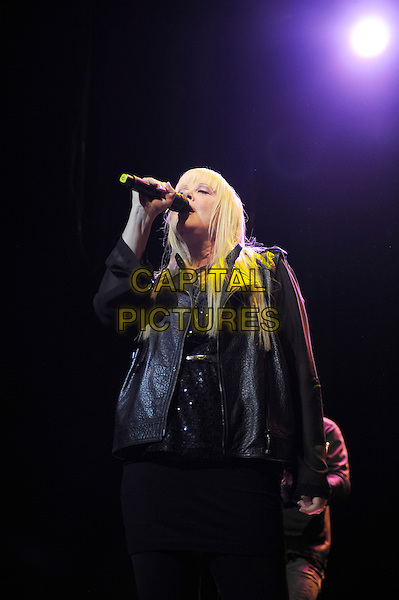 Cindy Wilson<br /> The B 52's performing in concert, Indigo2, Greenwich, London, England. 16th August 2013<br /> on stage in concert live gig performance performing music half length black leather jacket singing <br /> CAP/MAR<br /> &copy; Martin Harris/Capital Pictures
