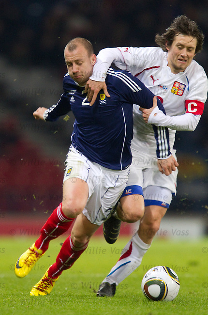 Alan Hutton and Tomas Rosicky