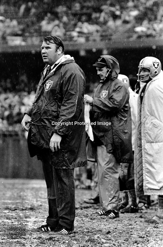 John Madden standing in the rain 1970 game. Photo by Ron Riesterer