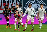 WASHINGTON, DC - MARCH 07: Felipe Martins #18 of DC United clears the ball past Wil Trapp #6 of Inter Miami during a game between Inter Miami CF and D.C. United at Audi Field on March 07, 2020 in Washington, DC.