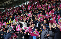 Burnley fans brandish flags as they welcome the teams onto the pitch<br /> <br /> Photographer Rich Linley/CameraSport<br /> <br /> The Premier League - Saturday 13th April 2019 - Burnley v Cardiff City - Turf Moor - Burnley<br /> <br /> World Copyright © 2019 CameraSport. All rights reserved. 43 Linden Ave. Countesthorpe. Leicester. England. LE8 5PG - Tel: +44 (0) 116 277 4147 - admin@camerasport.com - www.camerasport.com