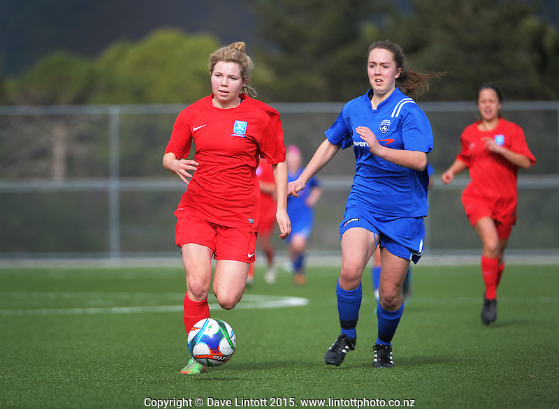 Action from the women's Kelly Cup football match between Petone (blue) and Seatoun (red) at Memorial Park, Petone, New Zealand on Sunday, 23 August 2015. Photo: Dave Lintott / lintottphoto.co.nz