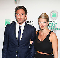 NHL player Henrik Lundqvist and guest attend the 13th Annual 'BNP Paribas Taste of Tennis' at the W New York.  New York City, August 23, 2012. © Diego Corredor/MediaPunch Inc. /NortePhoto.com<br />