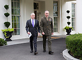 United States Secretary of Defense James Mattis (left) and the Chairman of the Joint Chiefs of Staff US Marine Corps General Joseph Dunford (right) walk to the microphones at The White House to make a statement on a possible military response to the recent North Korea missile launch, September 3, 2017. <br /> Credit: Chris Kleponis / Pool via CNP