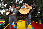 A mariachi band performing on a Trajinera raft. Xochimilco. Mexico City. Mexico