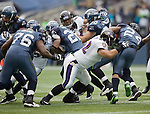 Baltimore Ravens defensive tackle Naloti Ngata tackles Seattle running back Marshawn Lynch behind the line of scrimmage at CenturyLink Field in Seattle, Washington on November 13, 2011. The Seahawks beat the Ravens 22-17.  ©2011 Jim Bryant Photo. All Rights Reserved.