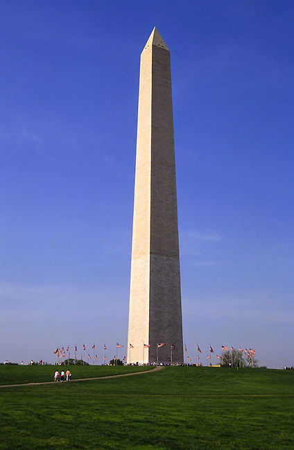 Washington Monument with flags in Washington DC, USA