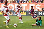 Rayo Vallecano´s Baena and goalkeeper Tono and Barcelona´s Pedro during La Liga match between Rayo Vallecano and Barcelona at Vallecas stadium in Madrid, Spain. October 04, 2014. (ALTERPHOTOS/Victor Blanco)