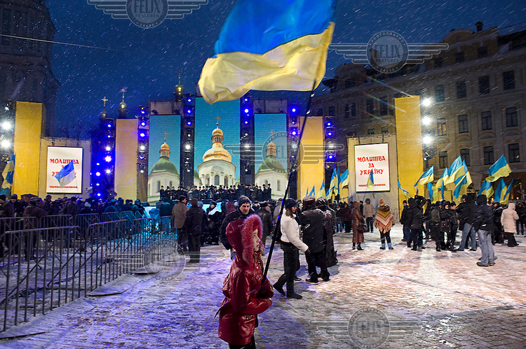 A child holds a Ukrainian flag at a rally held in Kyiv on the last day of legally permitted campaigning before the run-off Presidential election in Support of Yulia Tymoshenko. Tymoshenko narrowly lost the Presidential vote to Victor Yanukovich.