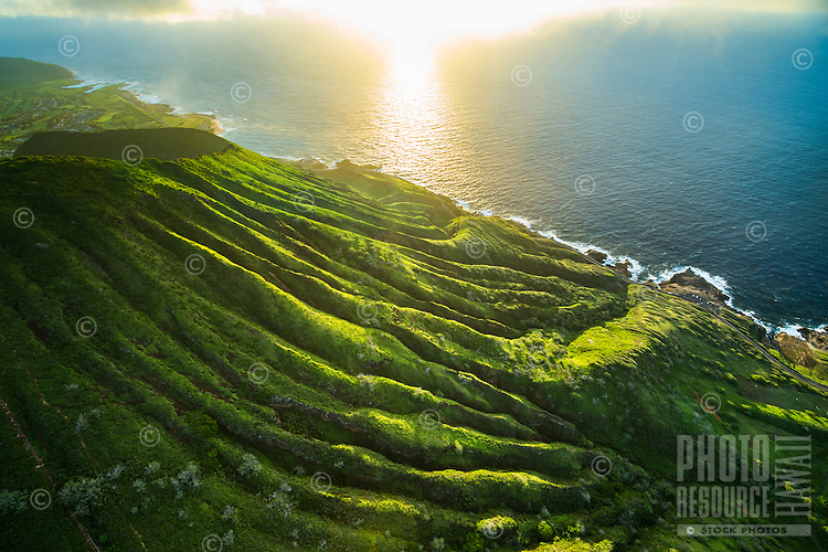A sunrise aerial view of Koko Crater, with the stairs of a hiking trial on its left side, eastern O'ahu.
