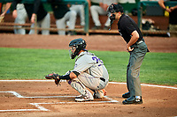 Javier Guevara (22) of the Grand Junction Rockies during the game against the Ogden Raptors at Lindquist Field on September 6, 2017 in Ogden, Utah. Home plate umpire Thomas Fornarola watches the warmup pitches. Ogden defeated Grand Junction 11-7. (Stephen Smith/Four Seam Images)