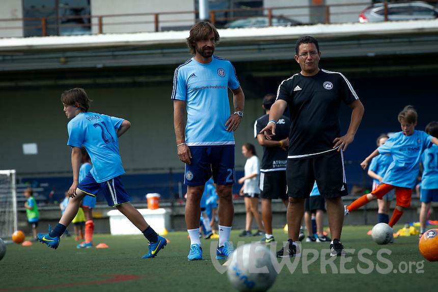 Andrea Pirlo (C ) attends a training with kids after a press conference with his new team New York City FC at Manhattan in New York. 07.23.2015.  Eduardo MunozAlvarez/VIEWpress.