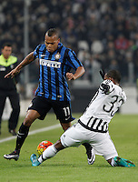 Calcio, semifinali di andata di Coppa Italia: Juventus vs Inter. Torino, Juventus Stadium, 27 gennaio 2016.<br /> FC Inter's Jonathan Biabiany, left, is challenged by Juventus&rsquo; Patrice Evra during the Italian Cup semifinal first leg football match between Juventus and FC Inter at Juventus stadium, 27 January 2016.<br /> UPDATE IMAGES PRESS/Isabella Bonotto