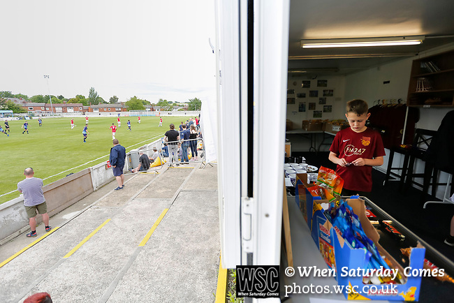 A young Ossett fan is tempted by sweets in the club shop. Yorkshire v Parishes of Jersey, CONIFA Heritage Cup, Ingfield Stadium, Ossett. Yorkshire's first competitive game. The Yorkshire International Football Association was formed in 2017 and accepted by CONIFA in 2018. Their first competative fixture saw them host Parishes of Jersey in the Heritage Cup at Ingfield stadium in Ossett. Yorkshire won 1-0 with a 93 minute goal in front of 521 people. Photo by Paul Thompson