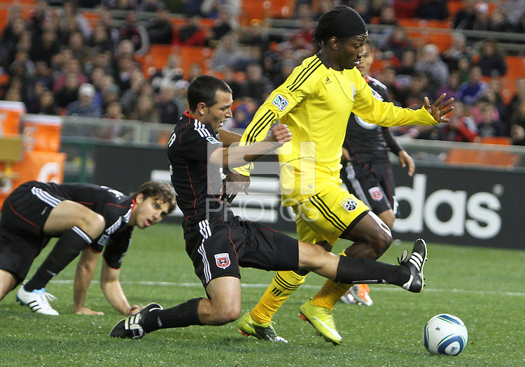 Jed Zayner#12 of D.C. United  pushes the ball away from Andres Mendoza#10 of the Columbus Crew during the opening match of the 2011 season at RFK Stadium, in Washington D.C. on March 19 2011.D.C. United won 3-1.