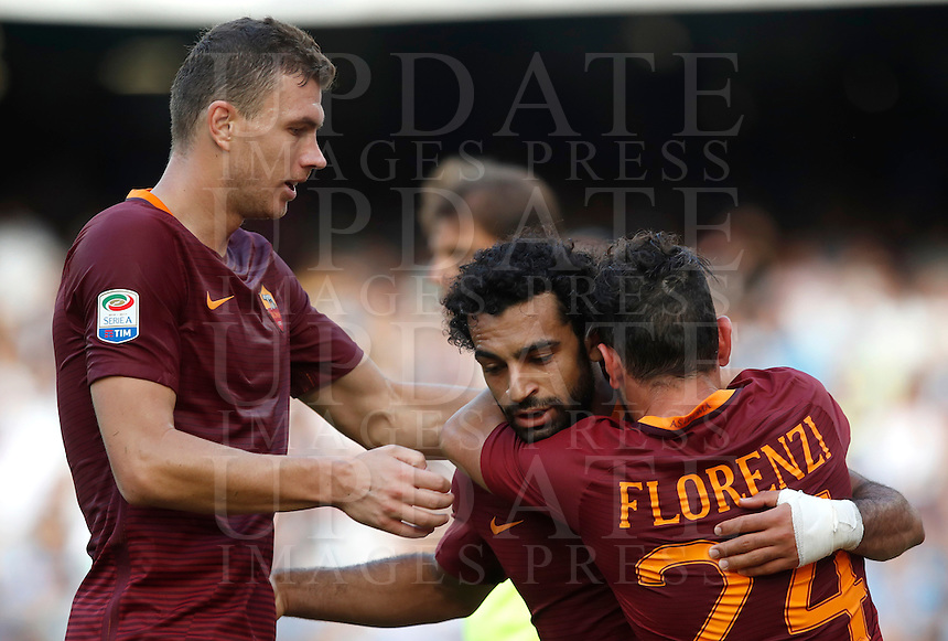 Calcio, Serie A: Napoli vs Roma. Napoli, stadio San Paolo, 15 ottobre. <br /> Roma's Mohamed Salah, center, celebrates with teammates Edin Dzeko, left, and Alessandro Florenzi, after scoring during the Italian Serie A football match between Napoli and Roma at Naples' San Paolo stadium, 15 October 2016. Roma won 3-1.<br /> UPDATE IMAGES PRESS/Isabella Bonotto