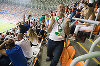 SARANSK, RUSSIA - June 25, 2018: An Iran fan reacts to an Iran missed goal during the 2018 FIFA World Cup group stage match between Iran and Portugal at Mordovia Arena.