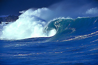 Beautiful wave cresting at the shore break of Waimea Bay on the North Shore of Oahu, Hawaii.