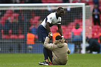 A fan tries to hug Moussa Sissoko of Tottenham Hotspur on the pitch after Tottenham Hotspur vs Leicester City, Premier League Football at Wembley Stadium on 10th February 2019