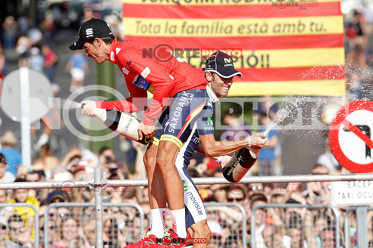 Alberto Contador, first classified (l) and Alejandro Valverde, second classified in the podium of of La Vuelta 2012.September 9,2012. (ALTERPHOTOS/Acero)