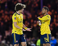 David Luiz of Arsenal left explains a point to Reiss Nelson of Arsenal during Portsmouth vs Arsenal, Emirates FA Cup Football at Fratton Park on 2nd March 2020