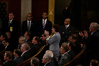 United States Senator Susan Collins, Republican of Maine, and Senator Angus King, Independent of Maine, stand and applaud while many Republican members of Congress sit after a comment by French President Emmanuel Macron as he delivers a joint address to the United States congress at the United States Capitol in Washington, DC on April 25, 2018. Credit: Alex Edelman / CNP /MediaPunch