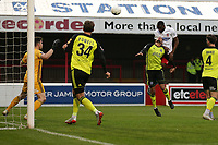 Emmanuel Onariase of Dagenham and Redbridge scores the third goal for his team during Dagenham & Redbridge vs Aldershot Town, Vanarama National League Football at the Chigwell Construction Stadium on 16th November 2019