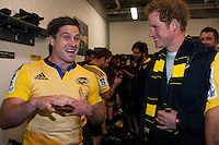 Prince Harry chats with Cory Jane in the changing rooms after the Super Rugby match between the Hurricanes and Sharks at Westpac Stadium, Wellington, New Zealand on Saturday, 9 May 2015. Photo: Dave Lintott / lintottphoto.co.nz