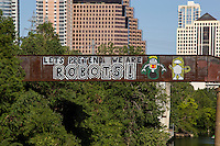"Austin is home to famous inspiring and colorful pop-art graffiti paintings such as the ""Let's Pretend we are ROBOTS!"" on the Austin Railroad Graffiti Bridge over Lady Bird Lake in downtown Austin, Texas."