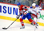 23 January 2010: Montreal Canadiens' center Maxim Lapierre keeps the puck from New York Rangers defenseman Wade Redden during a game at the Bell Centre in Montreal, Quebec, Canada. The Canadiens shut out the Rangers 6-0. Mandatory Credit: Ed Wolfstein Photo