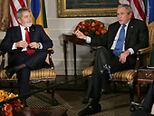 United States President George W. Bush, right, talks to the media as Brazil's president Luiz Lulu da Silva listens during their meeting at the Waldorf hotel on September 24, 2007 in New York City. Bush will be meeting with several heads of state who are in the city for the United Nation's General Assembly meeting. <br /> Credit: Monika Graff / Pool via CNP