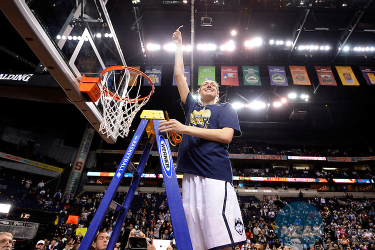 08 APR 2014:  Breanna Stewart (30) of the University of Connecticut cuts down the net after the Huskies victory against Notre Dame University during the Division I Women's Basketball Championship held at Bridgestone Arena in Nashville, TN.  Connecticut defeated Notre Dame 79-58 for the national title.  Jamie Schwaberow/NCAA Photos
