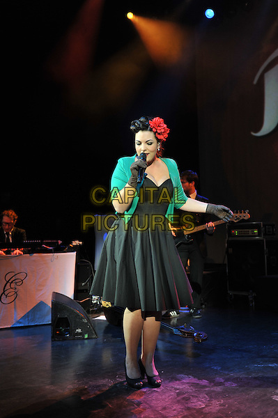 Caro Emerald (Caroline Esmeralda van der Leeuw).performing live in concert, Shepherd's Bush Empire, London, England..13th December 2011.on stage gig performance music full length black dress green jacket gloves flower in hair red singing   .CAP/MAR.© Martin Harris/Capital Pictures.