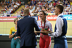Glasgow 2014 Commonwealth Games<br /> Elinor Barker (Wales) receiving her bronze medal from Sir Chris Hoy.<br /> Womens 10km Scratch Race<br /> Sir Chris Hoy Velodrome<br /> 26.07.14<br /> ©Steve Pope-SPORTINGWALES