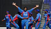 A winning smile and celebration from Afghan bowler Shapoor Zadran, taking an early wicket in theT20 World Cup Qualifying match against Scotland in Abu Dhabi - Picture by Donald MacLeod 10.02.10