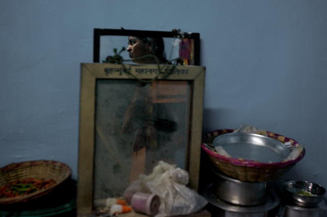 Shanta waits for customers in a brothel on 14th Lane, Kamathipura.