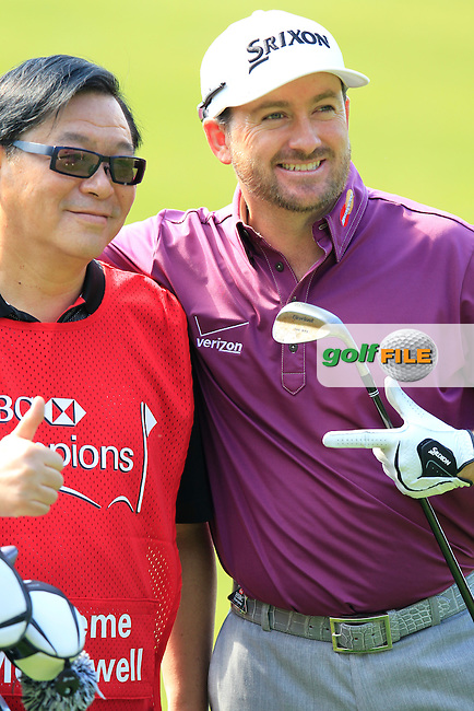 Graeme McDowell (NIR) tries a new caddy during Wednesday's Pro-Am day of the 10th Anniversary WGC - HSBC Champions 2014 held at Sheshan International Golf Club, Shanghai, China. 5th November 2014.<br /> Picture: Eoin Clarke www.golffile.ie