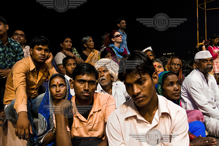 Pilgrims attend the evening prayers at the Dashashwamedh Ghat in the ancient city of Varanasi.