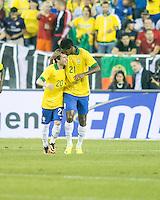 Brazil midfielder Bernard (20) and Brazil forward Jo (21) celebrate a Brazil goal.  In an International friendly match Brazil defeated Portugal, 3-1, at Gillette Stadium on Sep 10, 2013.