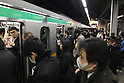 March 17, 2011, Tokyo, Japan - Commuters at Shinagawa Station in Tokyo attempt to make it home before the possible power outage planned in an attempt to conserve electricity. The power grid has been impacted heavily by the recent earthquake and its aftermath. (Photo by YUTAKA/AFLO) [1040]