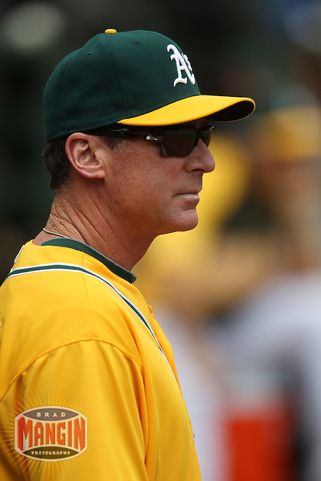 OAKLAND, CA - APRIL 25:  Manager Bob Melvin #6 of the Oakland Athletics watches from the dugout during the game against the Chicago White Sox at O.co Coliseum on Wednesday April 25, 2012 in Oakland, California. Photo by Brad Mangin