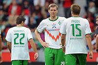 FUSSBALL   1. BUNDESLIGA   SAISON 2011/2012    2. SPIELTAG Bayer 04 Leverkusen - SV Werder Bremen              14.08.2011 Sokratis PAPASTATHOPOULOS, Per MERTESACKER und Sebastian PROEDL (v.l, alle Bremen) sind enttaeuscht