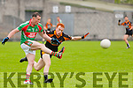 Mark Griffin (St MIchaels-Foilmore) in action with Bernard kelly (Austin Stack)) in the Garvey's SuperValu Senior County Football Championship 2015 at Austin Stack Park,Tralee on Saturday evening