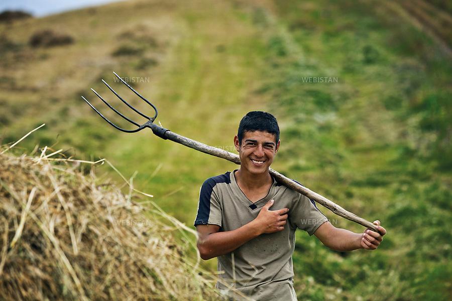 Azerbaijan, Lerik District, June 2, 2011<br /> A boy holds a pitchfork next to a pile of hay he has collected on a farm in Lerik, a district in the southern part of Azerbaijan, near the Iranian border. This mountain area has earned a reputation for being the &ldquo;home of people who live to a great age.&rdquo; <br /> <br /> Azerba&iuml;djan, district de Lerik, 2 juin 2011<br /> Un gar&ccedil;on tient une fourche &agrave; c&ocirc;t&eacute; d&rsquo;un tas de foin qu&rsquo;il a ramass&eacute; dans une ferme du district de Lerik. Situ&eacute; pr&egrave;s de la fronti&egrave;re iranienne, dans le sud de l&rsquo;Azerba&iuml;djan, le district est connu comme &eacute;tant &laquo; la terre de ceux qui vivent &acirc;g&eacute;s &raquo;.