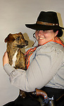 A cowgirl and a dingo dog