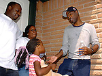 Actor/Comedian Chris Rock talks with Hurricane Katrina evacuees Jarmal and Myra McNeil and their daughter Jarlai Morris while on a visit to the Bonita House in Houston,Texas Thursday Sept. 29,2005.(Dave Rossman/For the Chronicle)