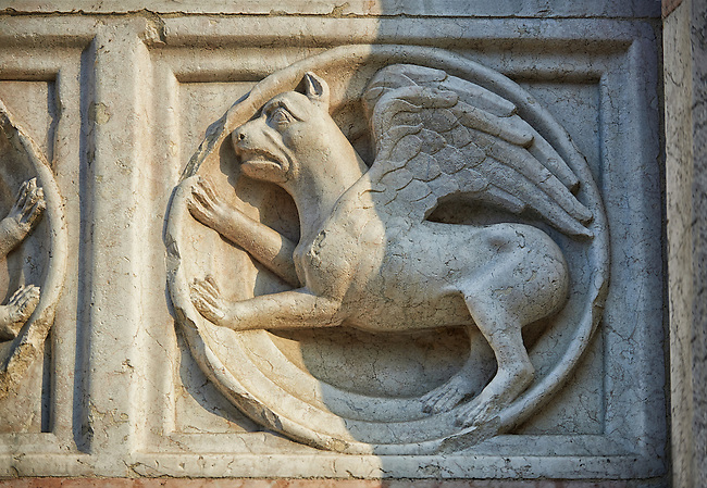 Medieval relief sculptures of mythical Griffin on the exterior of the Romanesque Baptistery of Parma, circa 1196, (Battistero di Parma), Italy