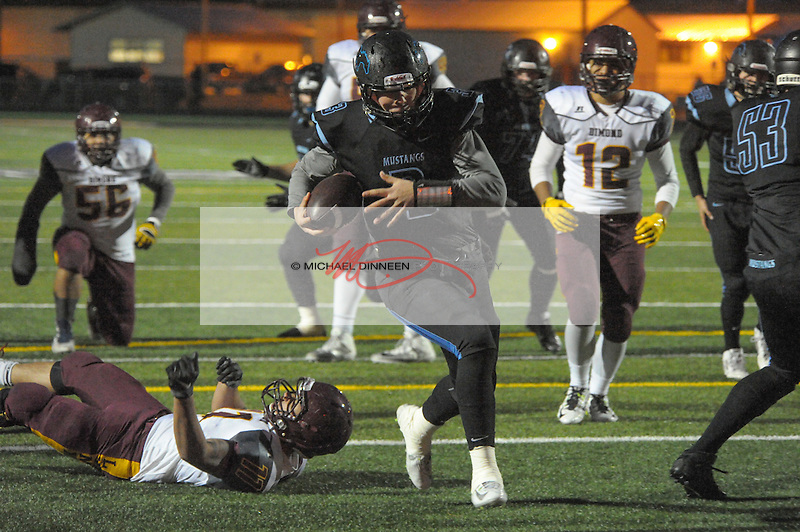 Chugiak's Ben Stewart calls his own number for a first-quarter touchdown.  Photo for the Star by Michael Dinneen