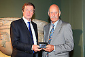 WOBURN, ENGLAND - AUGUST 30:  Mark James of England receives Honorary Membership of the European Tour from George O'Grady, Chief Executive of European Tour at the annual awards dinner held at Woburn Abbey prior to the Travis Perkins plc Senior Masters played at the Duke's course, Woburn Golf Club on August 30, 2012 in Woburn, United Kingdom.  (Photo by Phil Inglis/Getty Images) *** Local Caption *** George O'Grady; Mark James